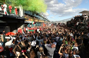Race winner Sebastian Vettel of Germany and Ferrari, second place Lewis Hamilton of Great Britain and Mercedes GP and third placed Kimi Raikkonen of Finland and Ferrari celebrate on the podium during the Australian Formula One Grand Prix at Albert Park.