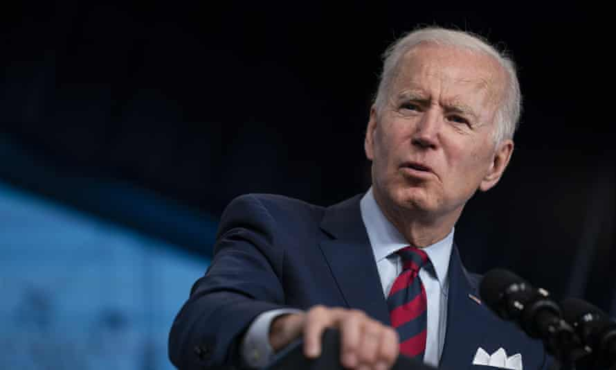 Close-up of Joe Biden, shot at a slight angle as he speaks from a podium at the White House