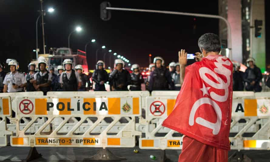 A man demonstrates against the impeachment in front of the National Congress in Brasilia.
