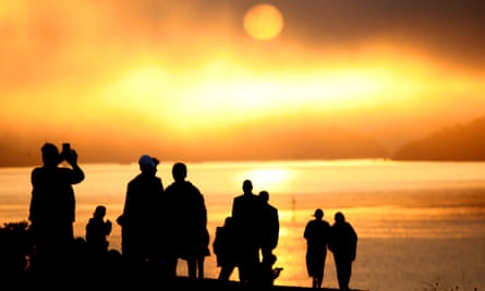 People watch the sun rise from the Treaty Grounds in Waitangi, New Zealand. The Mana Motuhake policy is based on Māori asserting their right to self-management, self-determination, and self-governance over all their domains.