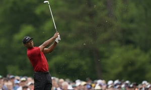 Tiger Woods plays safe and finds the par-three 12th green during the final round of the Masters after watching two other players hit into the water.