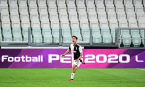 Paulo Dybala celebrates in front of empty stands at the Allianz Stadium.