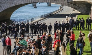 Police disperse gatherings on the banks of the Seine in Paris on Saturday.