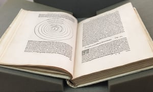 Large book on grey foam pads; dense printed text on both pages; an image composed of many concentric circles takes up about two thirds of the left hand page.