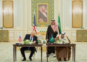 Donald Trump and King Salman sign a $110bn arms deal at the Saudi Royal Court in Riyadh.