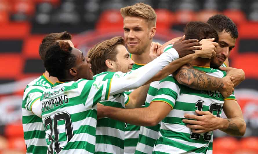 Albian Ajeti is congratulated by his Celtic teammates after scoring a late winner against Dundee United on Saturday.
