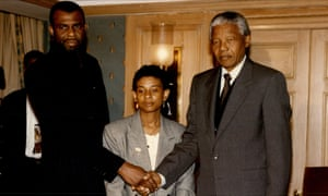 Nelson Mandela with Neville and Doreen Lawrence.