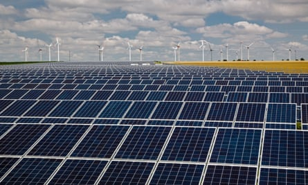 Wind Turbines of an onshore wind farm and solar panels containing photovoltaic cells at the Solarpark are pictured on July 17, 2013 near Grischow, Germany.