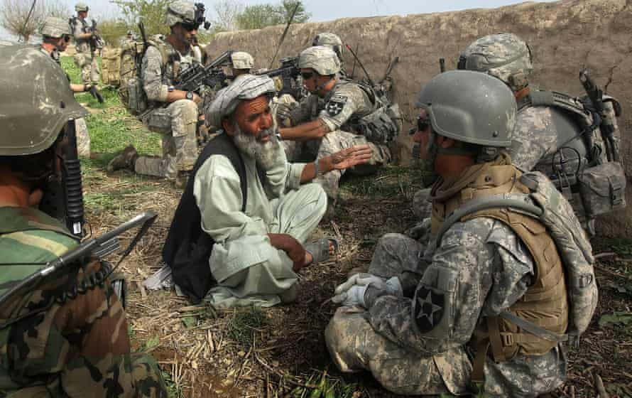 US and Afghan soldiers question a farmer after a firefight with the Taliban in Kandahar province, Afghanistan, in 2010.