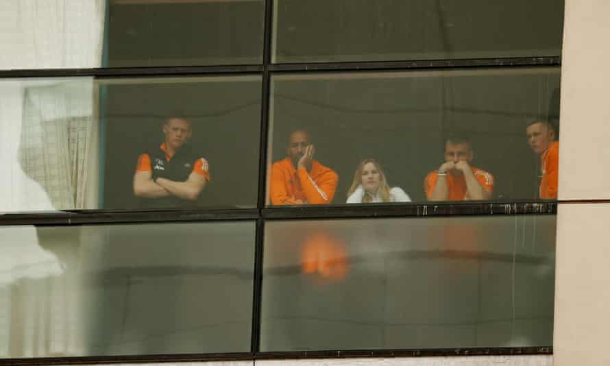 Scott McTominay, Luke Shaw and Lee Grant watch the protest from the window of the Lowry hotel