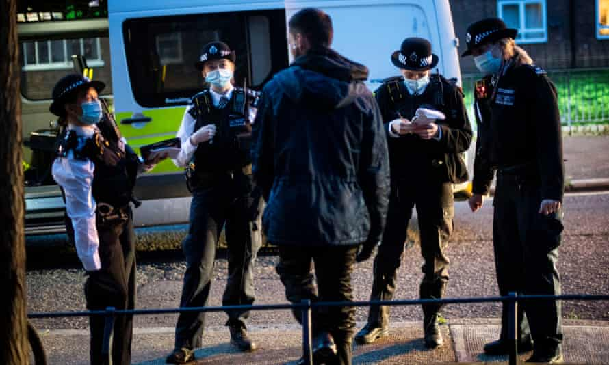 Officers and special constables talk to a suspect following a stop and search in south London.