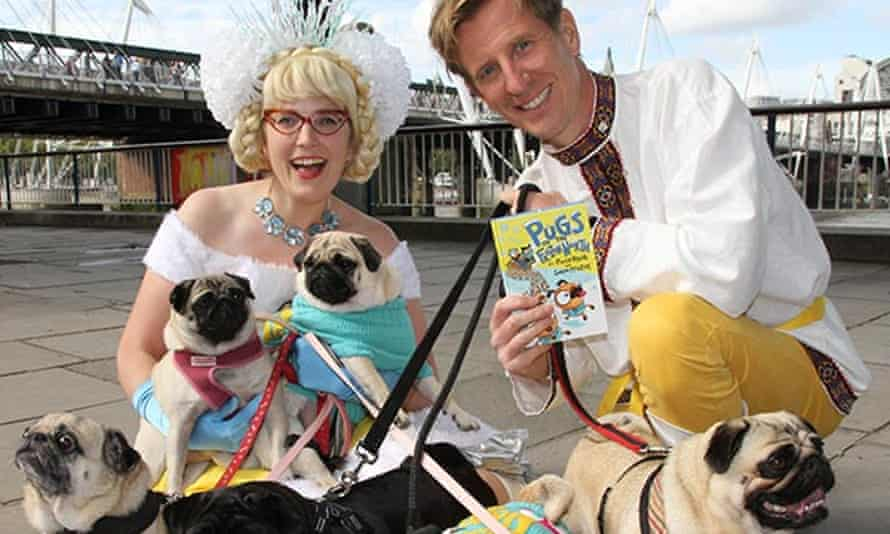 Sarah McIntyre and Philip Reeve with a host of pugs.