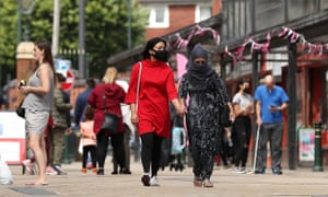 Shoppers in Oldham,Greater Manchester, wear face masks.