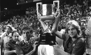 Quini (left) and and his Barcelona team-mate Bernd Schuster hold aloft the Copa del Rey after defeating Sporting Gijón at the Vicente Calderón in Madrid in June 1981, three months after he was kidnapped.