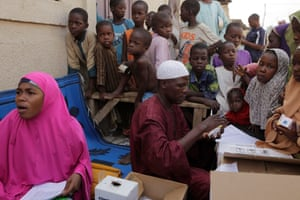 Nigerian children in Kawo Kano wait to be vaccinated against polio