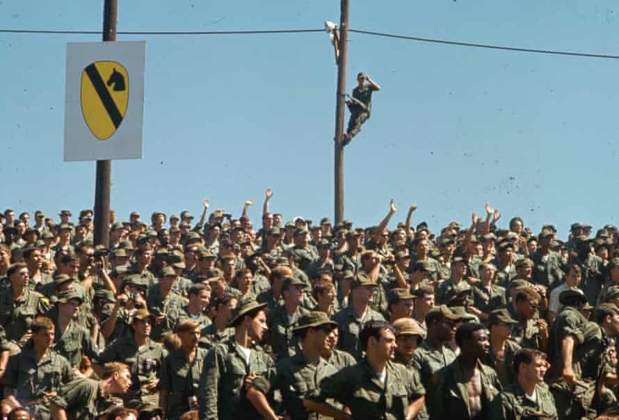 Entertaining the troops… the soldiers see a show in Vietnam.