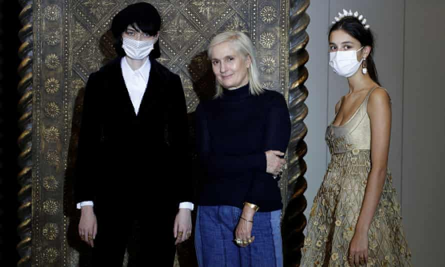 Maria Grazia Chiuri with two models.