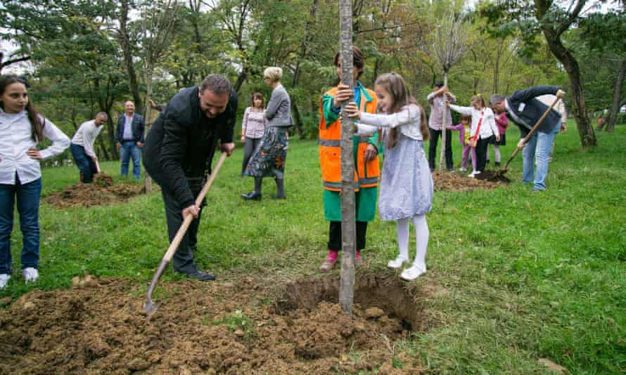 Families plant 'birthday trees' for children.