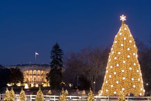 2005 - The brightly shining National Christmas Tree in Washington DC with a glowing White House in the background.