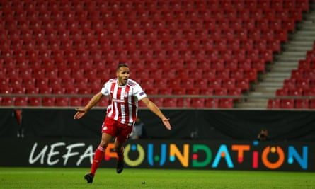 Youssef El Arabi celebrates after scoring for Olympiacos against Wolves in the Europa League in March.