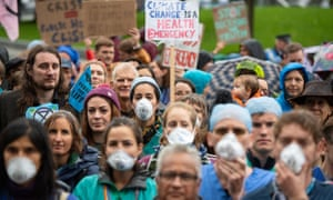 Doctors gather to protest in support of Extinction Rebellion in London.