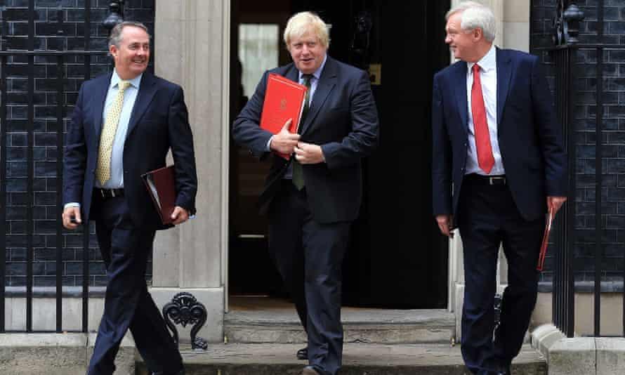 Liam Fox, Boris Johnson and David Davis leave Downing Street
