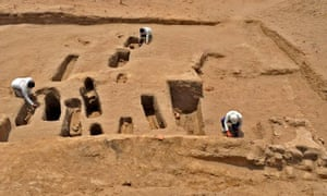 Archaeologists investigate graves discovered at Chotuna-Chornancap, including those of two children without feet, in this picture released by the Peruvian ministry of culture.