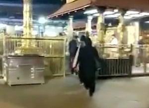 Two women enter the Sabarimala temple in Kerala, India