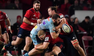 Exeter's Luke Cowan-Dickie loses possession as he is tackled by Jeremy Loughman and Arno Botha of Munster during their Champions Cup clash.