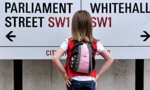 child looking at a street sign between Parliament Street and Whitehall