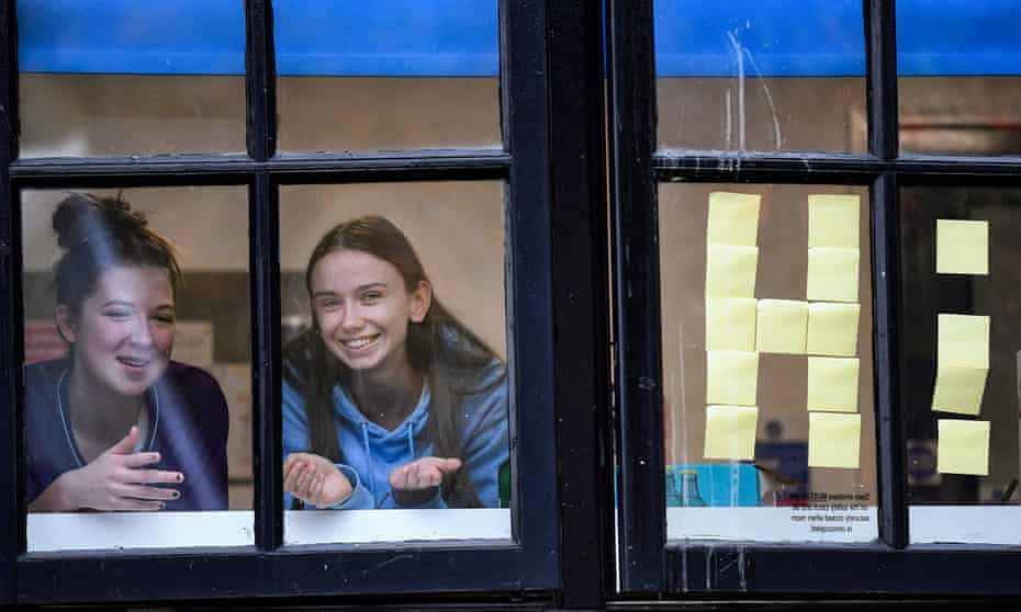 Students from Glasgow University look out of the windows of the student accommodation at Murano Street student village