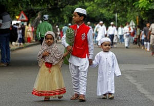 Children arrive at a mosque to offer Eid al-Adha prayers, India