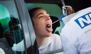 Testing person in car at Edinburgh airport for coronavirus
