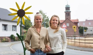 Pernille Harder (L) and girlfriend Magdalena Eriksson pose for a photograph.