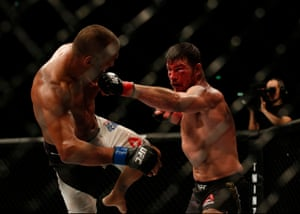 Michael Bisping throws a left at Dan Henderson.