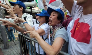 Pro-China supporters shout at pro-democracy demonstrators in Hong Kong.