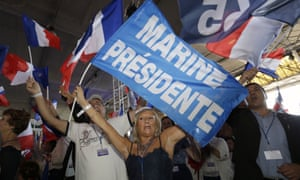 Supporters of Le Pen wave flags during the summer conference.