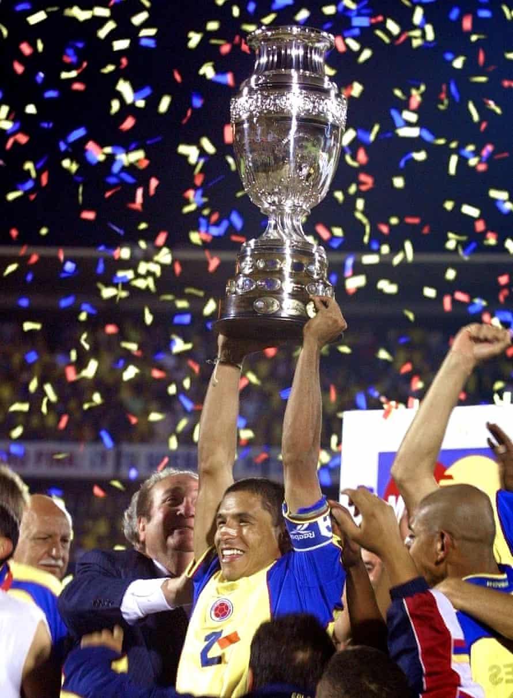 Colombia's goalscorer Iván Córdoba holds the Copa América trophy aloft in July 2001.