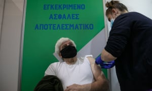 A man receives the Covid-19 vaccine in Athens, Greece.