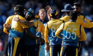 The Sri Lanka players celebrate the win.