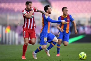 Saul Niguez fouls Barcelona's Lionel Messi and goes into the ref's book.