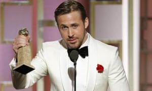 Total sweetheart … Ryan Gosling picks up his award.