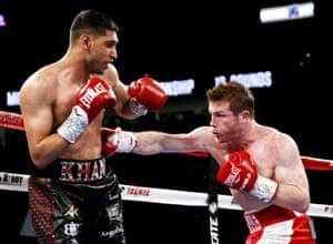 Álvarez tags Khan with a body shot.