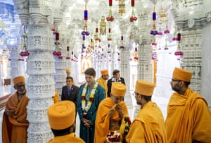 Canada's prime minister, Justin Trudeau, and Toronto's mayor, John Tory, visit the Baps Shri Swaminarayan Mandir to celebrate the 10th anniversary of the Hindu temple in Mississauga