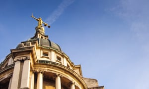 A statue of Justice stands over England's Central Criminal Court on London's Old Bailey.