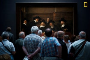 Museum visitors look at painting
