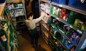 A volunteer at a Trussell Trust food bank in Wandsworth, south-west London, prepares a parcel of donated items.