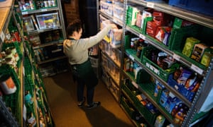 A volunteer at Wandsworth food bank, south London: 'Mumford's opinions on economic intervention align him with the left'