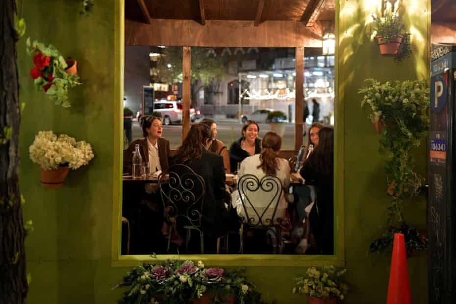 People enjoy an evening out in Greenwich Village in April.