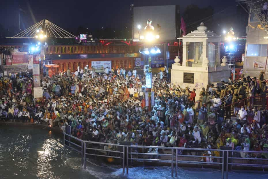 Devotees sit and pray in the evening on the ghats of the Ganges on 12 April
